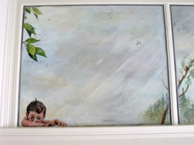 Curious boy looking down from painted skylight